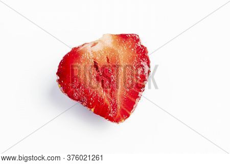 Shot On A White Background. Juicy Red Strawberries. The Cut In Half. Close-up