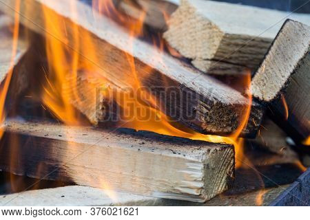 Flame Incinerates Firewood And Transforms It Ashes, Close Up, Shallow Depth Of Field. Blaze In A Lar