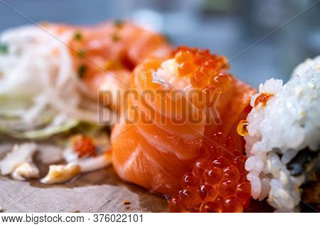Japanese Food, Sushi Or Sashimi Made From Rice With Salmon, Avocado, Cucumber, Red Fish Caviar, Temp