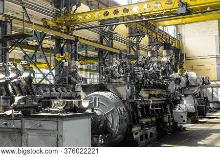 Diesel Locomotive Engine In A Repair Depot Workshop With Overhead Crane