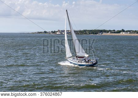 New Bedford, Massachusetts, Usa - July 11, 2020: Sailboat Tacking Her Way Across New Bedford Outer H