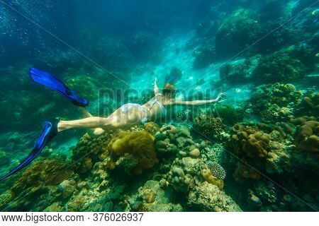 Woman Snorkeling In White Bikini Swimming Deep In Coral Reef Of Surin Islands, Andaman Sea, North Of