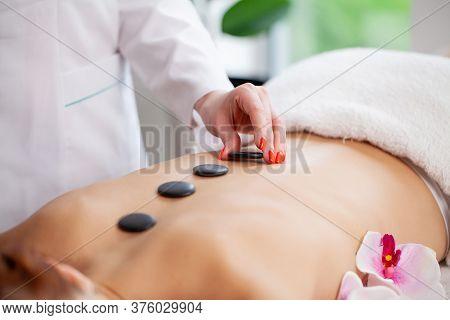 Spa Stone Massage, Beautiful Woman Getting Spa Hot Stones Massage In Spa Salon.