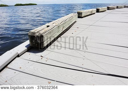 Dock Located In Biscayne National Park In Homestead, Florida, Dock And Blue Ocean Water.