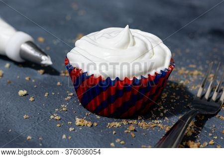 Cupcake With Cream In A Table With Cutlery And Crumbs