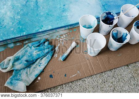Arts And Craft Hobbies Concept, Blue And White Acrylic Painting With Colors In Plastic Cups And Mixe
