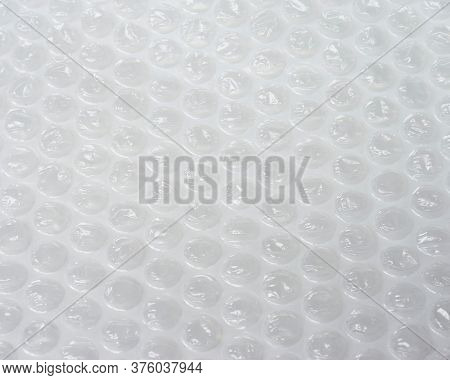 Bubble wrap. Plastic packaging material. Close-up photo. Free antistress. Abstract light background