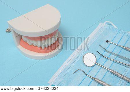 Dental Tools On Blue Background. Medical Technology Concept. Dental Hygiene. Cure Concept. Dentist T