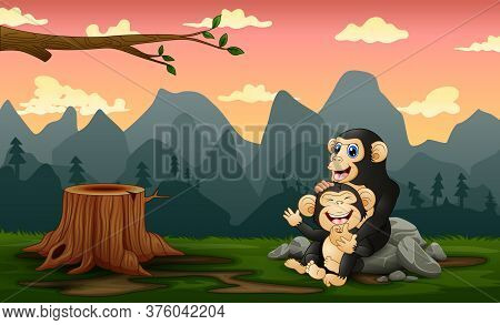 A Chimpanzee With Her Cub In A Bare Forest