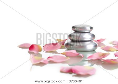 Pile Of Round Pebble Stone With Rose Petals
