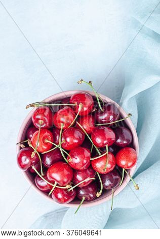 Cherry With Leaf On Plate And Water Drops On Grey Stone Table. Ripe Ripe Cherries. Sweet Red Cherrie