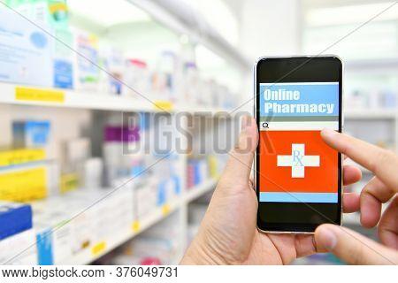 Pharmacist Using Mobile Smart Phone For Search Bar On Display In Pharmacy Drugstore Shelves Backgrou