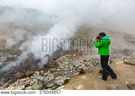 Girl Photographer Takes Pictures Of Stunning Volcanic Landscape, Aggressive Hot Spring, Eruption Fum