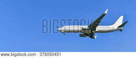 Commercial Airplane Isolated On A Blue Sky Background,copy Space