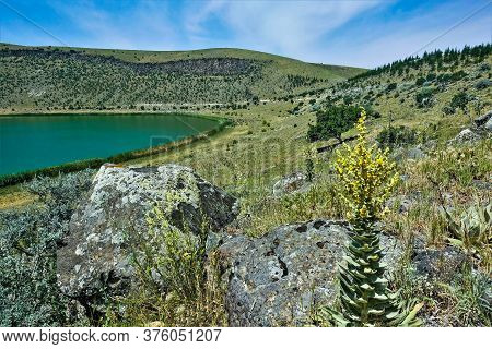 Emerald Lake Nar In The Crater Of An Extinct Volcano. Summer Sunny Day. On The Slopes Of The Mountai