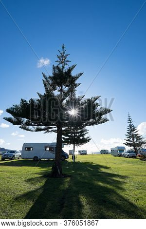 Northland, New Zealand, Nz - July 12, 2020: Campervans And Motorhomes At Tauranga Bay In Winter