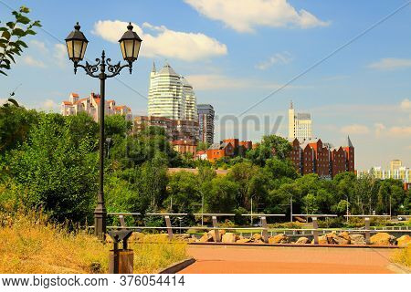 Beautiful Spring And Summer View Of Big City, Red Buildings, White Skyscrapers, Vintage Lantern And