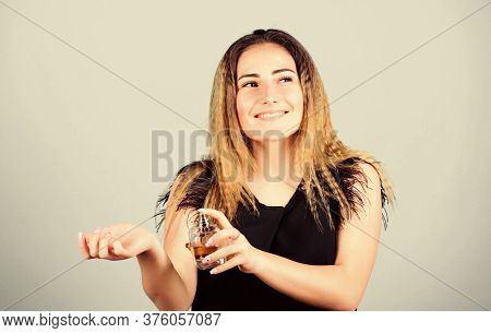 Pretty Woman With Bottle Perfume. Wearing Fragrance Is Easy. Pick Perfume. Cosmetics Shop. Beauty Pr