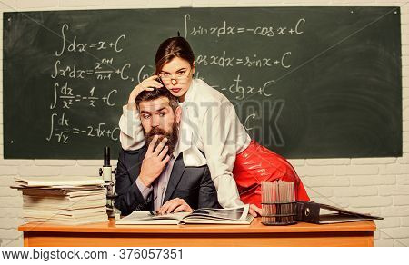 School And Sexual Behavior. Confused Teacher Under Domination Of Sensual Student. Man Under Woman Do