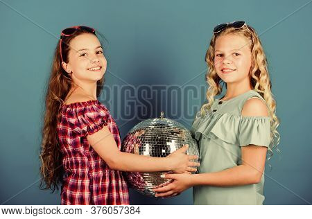 Sisters Friends With Disco Ball. Lets Start Party. Cheerful Kids Hold Disco Ball. Disco Dances. Retr