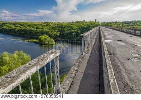 Dilapidated Unsafe Bridge Over River. Abandoned Building Of Emergency Condition
