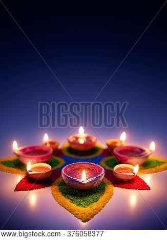 Happy Diwali, Diya Oil Lamps On Colorful Rangoli With Copy Space