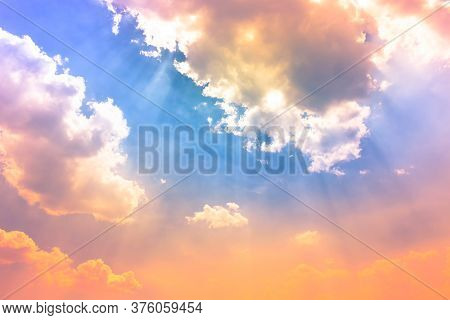 Light Of Heaven On Color Sky,orange Pink And Yellow Sun Light In Blue Sky With Soft Clouds