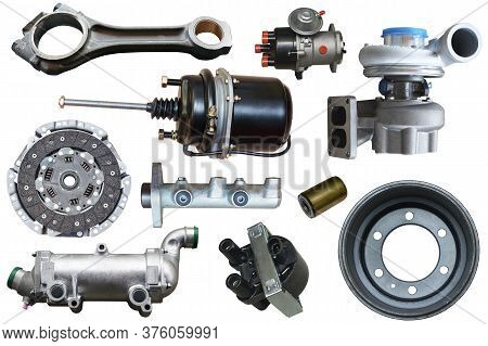 Car Spare Parts On A White Background. A Set For Advertising Assembled Auto Parts. New Parts For Veh