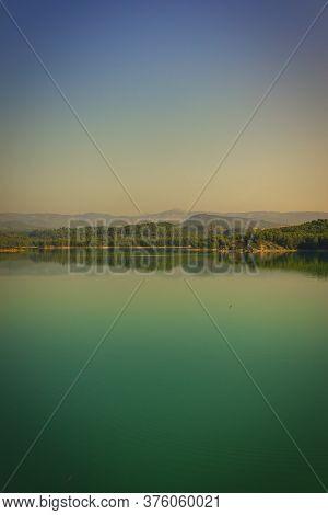 Quiet Sunrise At A Reservoir In Castellon, Valencia