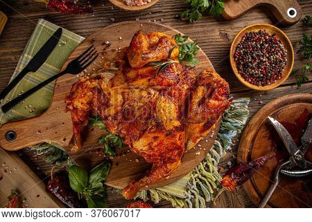 Grilled Fried Roast Chicken On Wooden Cutting Board, Top View
