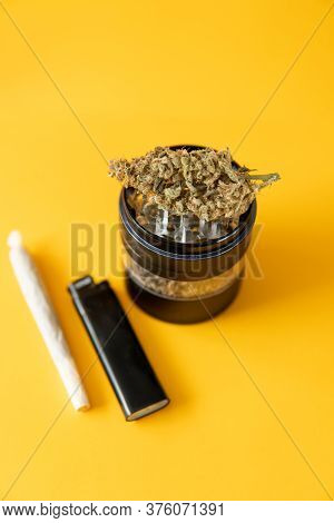 Marijuana Weed Bud And Grinder. The Pot Leaves On Buds. Indica Medical Health. Cannabis Nature Bud.