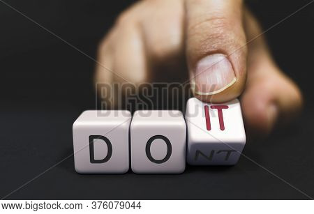 Do Not Changes To Do It - Business Concept Of Choice. Hand Turns A Dice And Changes The Word Dont To