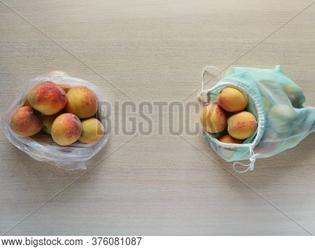Peaches In Plastic Bag And Reusable Bag. Peaches In Plastic Bag And Reusable Bag.