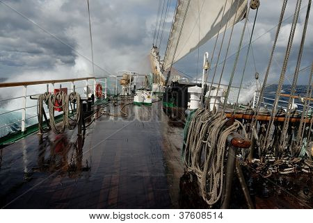 Sailing ship in a storm on the ocean