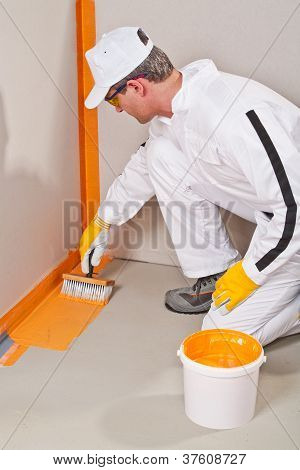 Worker Waterproofing Around The Wall And Floor
