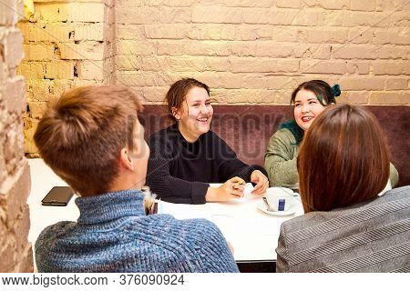 Kirov, Russia - September 17, 2019: People At Table In Cafe Or Restaurant During Intellectual Game.