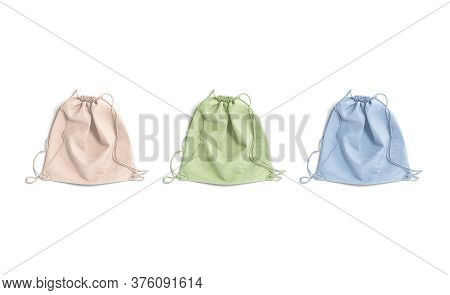 Blank Colored Drawstring Backpack Mock Up Lying, Top View, 3d Rendering. Empty Pink, Green, Blue Tex