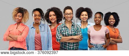 civil rights, ethnicity and people concept - group of happy african american women over grey background