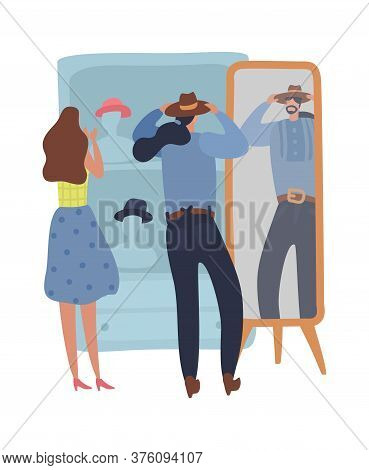 People Shopping Second Hand. Man Tries On Hat In Front Of Mirror, A Woman Chooses Product, Shoppers