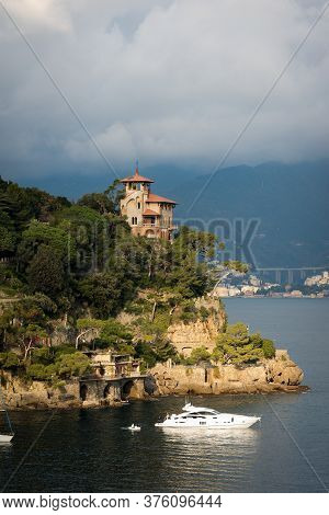 Portofino, Liguria, Italy - Dec 9, 2016: Luxury Yacht And Ancient Villa In The Port Of The Famous An