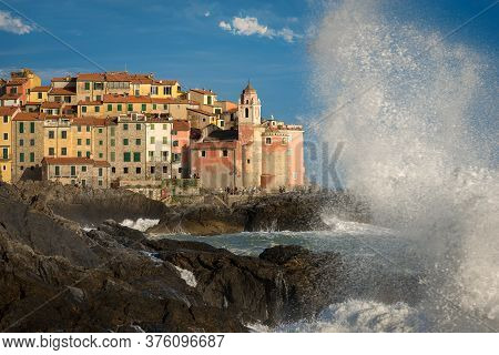 Tellaro, Italy - July 13, 2016: Big Waves In The Mediterranean Sea. Ancient Village Of Tellaro Durin