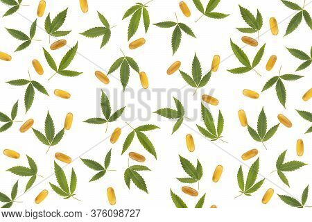 Hemp Extraction Oil In Capsules Near Cannabis Leaves Isolated On White Background. Cannabis Pattern
