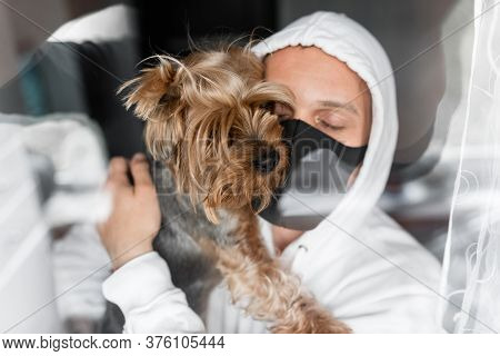 Man In A Black Mask, Masked Guy On Self-isolation With A Yorkshire Terrier Puppy, Boy With Puppy