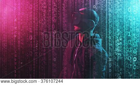 Portrait Of A Man In Virtual Reality Helmet Over Abstract Digital Background. Obscured Dark Face In