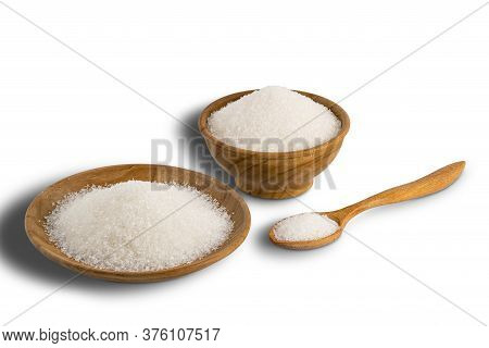 Refined Granulated Sugar In Wooden Bowl, Wooden Plate And In Wooden Spoon On White Background With C