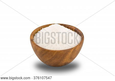Refined Granulated Sugar In Wooden Bowl On White Background With Clipping Path.
