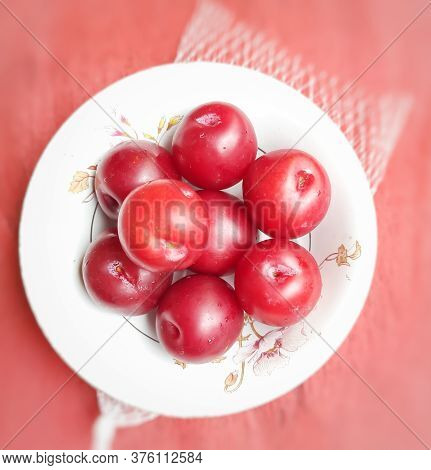 Colorful Red Plums Kept In Bowl Placed In Red Backgrounds And Reduce The Risk Of Cancer Heart Diseas