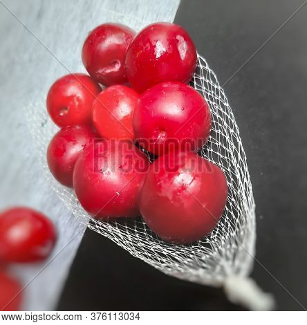 Colorful Red Plums Kept In Fruit Cover Placed In Black Background And Reduce The Risk Of Cancer Hear