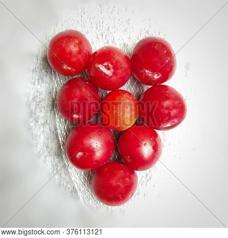 Colorful Red Plums Kept In Bowl Placed In White And Black Background And Reduce The Risk Of Cancer H