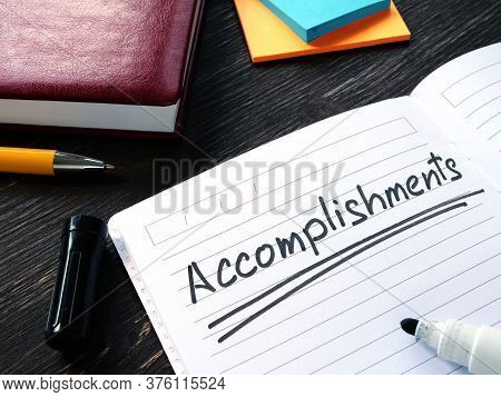 Accomplishments List In The Notebook On The Desk.